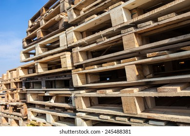 The big stack of wooden cargo pallets.