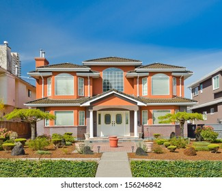 Big standard middle class house in a residential neighborhood. Vancouver, Canada