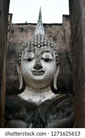ฺPerspective big statue of Buddha in Sri Chum Temple is a historic site in the Sukhothai Historical Park. Sukhothai Province,Thailand for illustration buddhist religion or tourism concept.