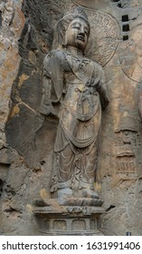 Big statue made in limestone of bodhisattvas. The main cave (Fengxiangsi Cave) of Longmen Grottoes in Luoyang . A world heritage Site in Henan province, China.