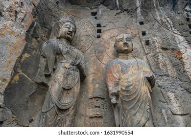Big statue made in limestone of monks and bodhisattvas. The main cave (Fengxiangsi Cave) of Longmen Grottoes in Luoyang . A world heritage Site in Henan province, China.