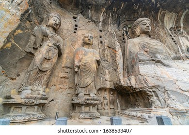 Big statue made in limestone of Vairocana Buddha,  monks and bodhisattvas. The main cave (Fengxiangsi Cave) of Longmen Grottoes in Luoyang . Henan province, China.