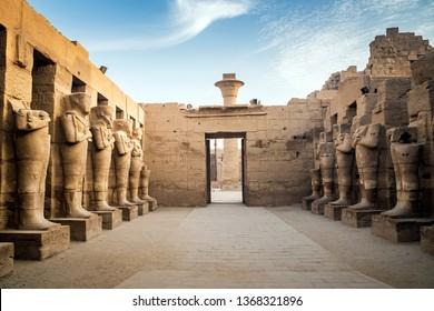 Big statues of Pharaoh Ramses II as osiris guarding the precinct of the temple of Karnak, in the east bank of the Nile River, El-Karnak, Luxor, Egypt