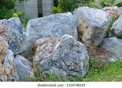 big stone on the grass