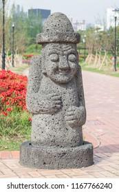 Big stone statue of hareubang, Jeju island idol, shot in Yurim park Daejeon, South Korea