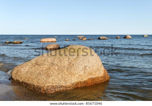 Big stones in the Baltic sea water.