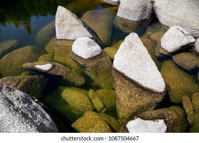 Big stones in mountain lake