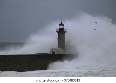 Big storm near a lighthouse in Oporto, Portugal