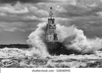 Big storm near an old lighthouse in Achtopol bay, Black sea, Bulgaria