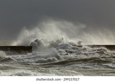 Big stormy Atlantic wave against pier from portuguese west coast