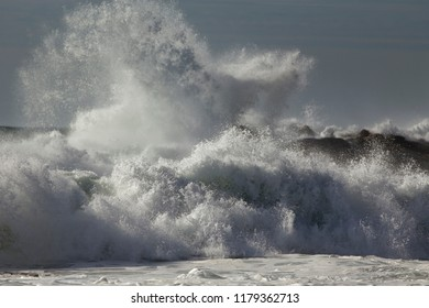 Big stormy breaking waves. Focus on the foreground wave.
