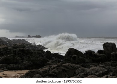 Big stormy breaking waves. Northern portuguese rocky coast.