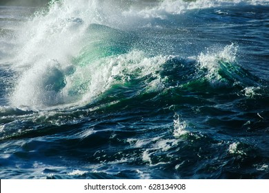 Big stormy ocean wave. Blue water background