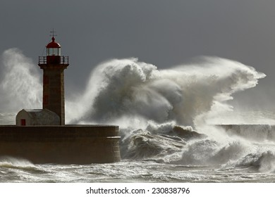 Big stormy waves against lighthouse with interesting light. Porto, Portugal.  Low edition photo.