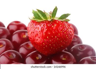 big strawberry over fresh cherries layer