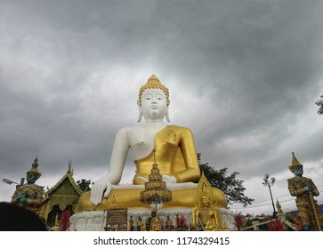 The big beautiful bhudda with the big strom in background.