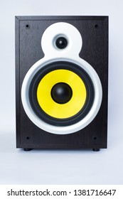 big subwoofer with yellow speaker on white background,loud music close-up