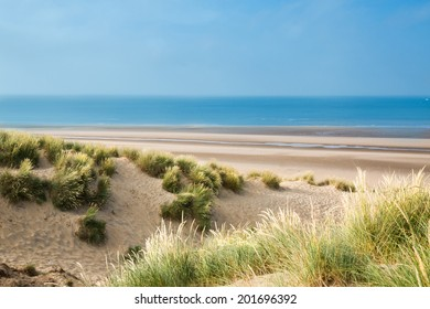 Big sunny empty beach with dunes in summer - Camber Sands, East Sussex, England