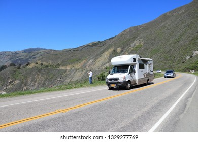 BIG SUR, USA - APRIL 7, 2014: Motorhome tourists drive along Pacific Coast Highway in California. Pacific Coast Highway is one of most recognizable scenic roads in America.