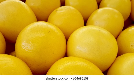 Big sweet yellow pomelo closeup
