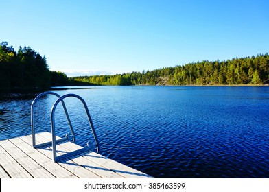 """Big swimming pool in nature, """"Cloud"""" lake in Finland. Clear and blue sky"""