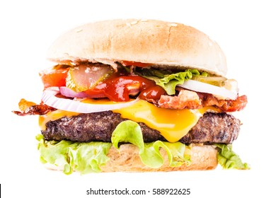 a big and tasty bacon cheeseburger isolated over a white background
