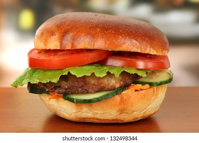 Big and tasty hamburger on table in cafe