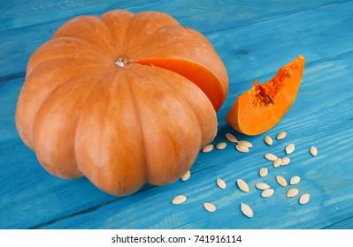 Big tasty pumpkin on the blue background. Food concept.