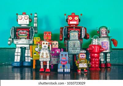a  big team of retro robots on a wooden floor