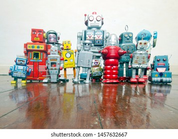 a big team of robots on an old wooden floor