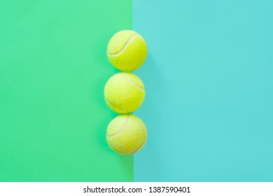 Big tennis ball on blue background. Trendy minimal design top view pastel colours