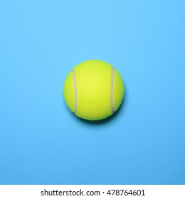Big tennis ball on blue background - Trendy minimal design top view