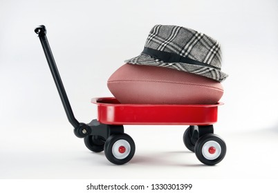 Big texas football in a little red wagon.