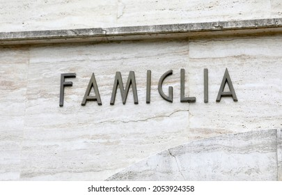 big text FAMIGLIA that means family in Italian language