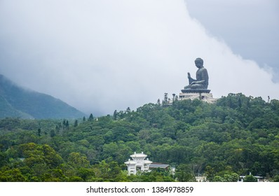 The big Tian Tan Buddha statue up on high green mountain near Po Lin Monastery, Ngong Ping village in Lantau Island, Hong Kong