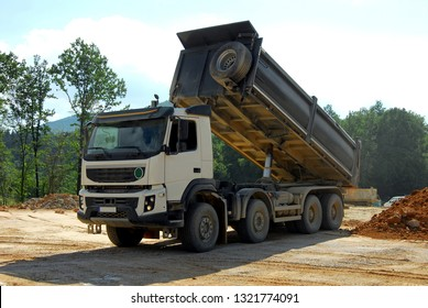 big tipper truck unloading land on the site