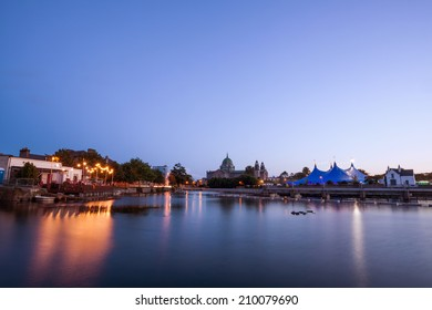 """""""Big Top"""" circus style blue tent and Galway Cathedral on the bank of Corrib river in Galway, Ireland"""