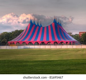 big top circus tent on a field in a park, built up for a music festival