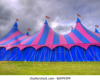 Big top circus tent on a field with brooding sky