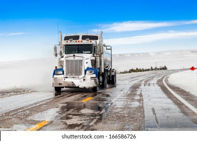 big truck drives on snow highway