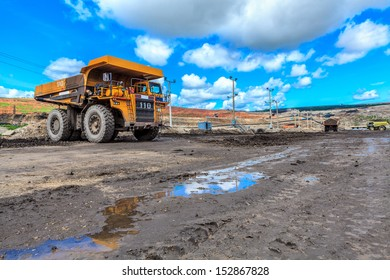 big truck in open pit and blue sky at mae mo Mine