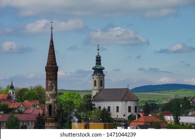 Big Turkish Minaret and church bell tower in Eger cityscape, Hungary