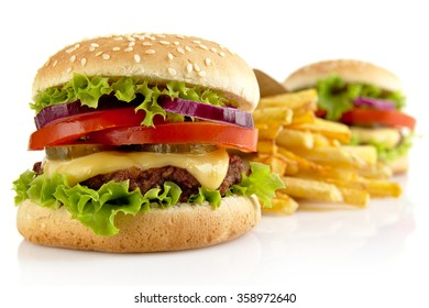 Big two cheeseburgers with french fries isolated on white background