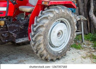 Big tyre of the tractor used in india for farming machine, rubber close-up, background - image