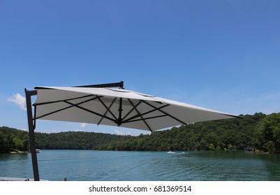 Big umbrella canopy by the lake