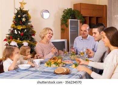Big United Happy Family At Festive Table Near Christmas Tree