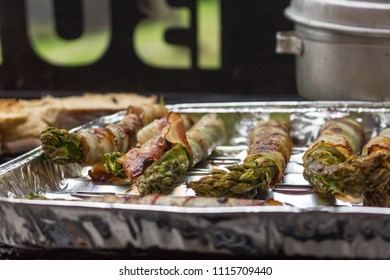 Big variety of diferent meat and vegetables beeing grilled. Closeup.