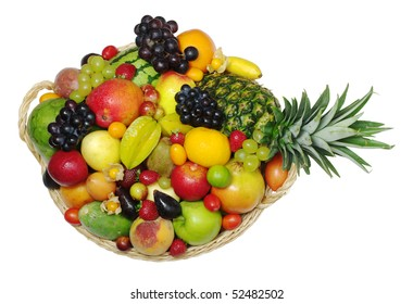A big variety of exotic fruits in a basket  (isolated)