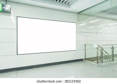 big vertical poster on metro station
