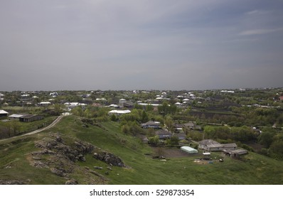 Big village in Moldova. There are a stone slope and view of the village.